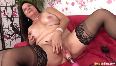 Sexy and horny mature woman enjoys their pussies drilled by fucking machines