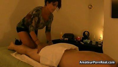 Hot brunette gives erotic massage to regular buyer