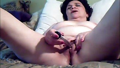 Elder statesman lady spread legs added to masturbating till cum