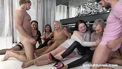Four young men fuck team a few oversexed old women