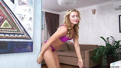 Scalding blondie Maya Konovalenko takes off her purple attire