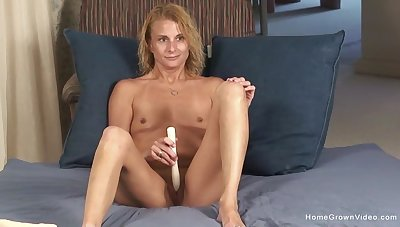 Pithy tits blonde model opens her legs to play fro a dildo