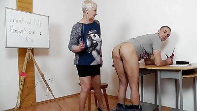 Older Female Instructor Punishes Handsome Guy