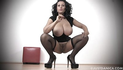 Busty MILF Danica Collins with respect to stockings and high heels playing