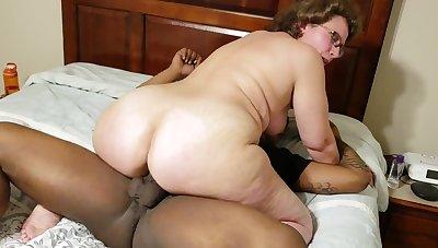 Busty mature grandma with big ass in homemade interracial hardcore
