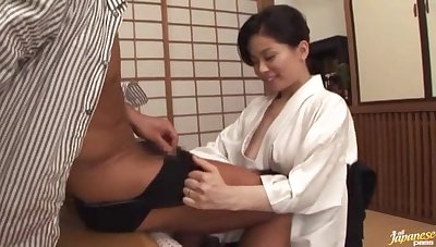 Japanese wife Miki Sato drops on her knees to give a titjob